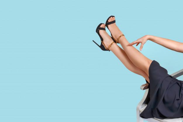 well-groomed-female-legs-high-heeled-sandals-pedicure-depilation-treatment-varicose-veins_114937-213