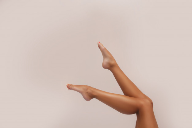 woman-body-care-close-up-long-female-tanned-legs-with-perfect-smooth-soft-skin-pedicure-epilation-beauty-health-concept_124463-472
